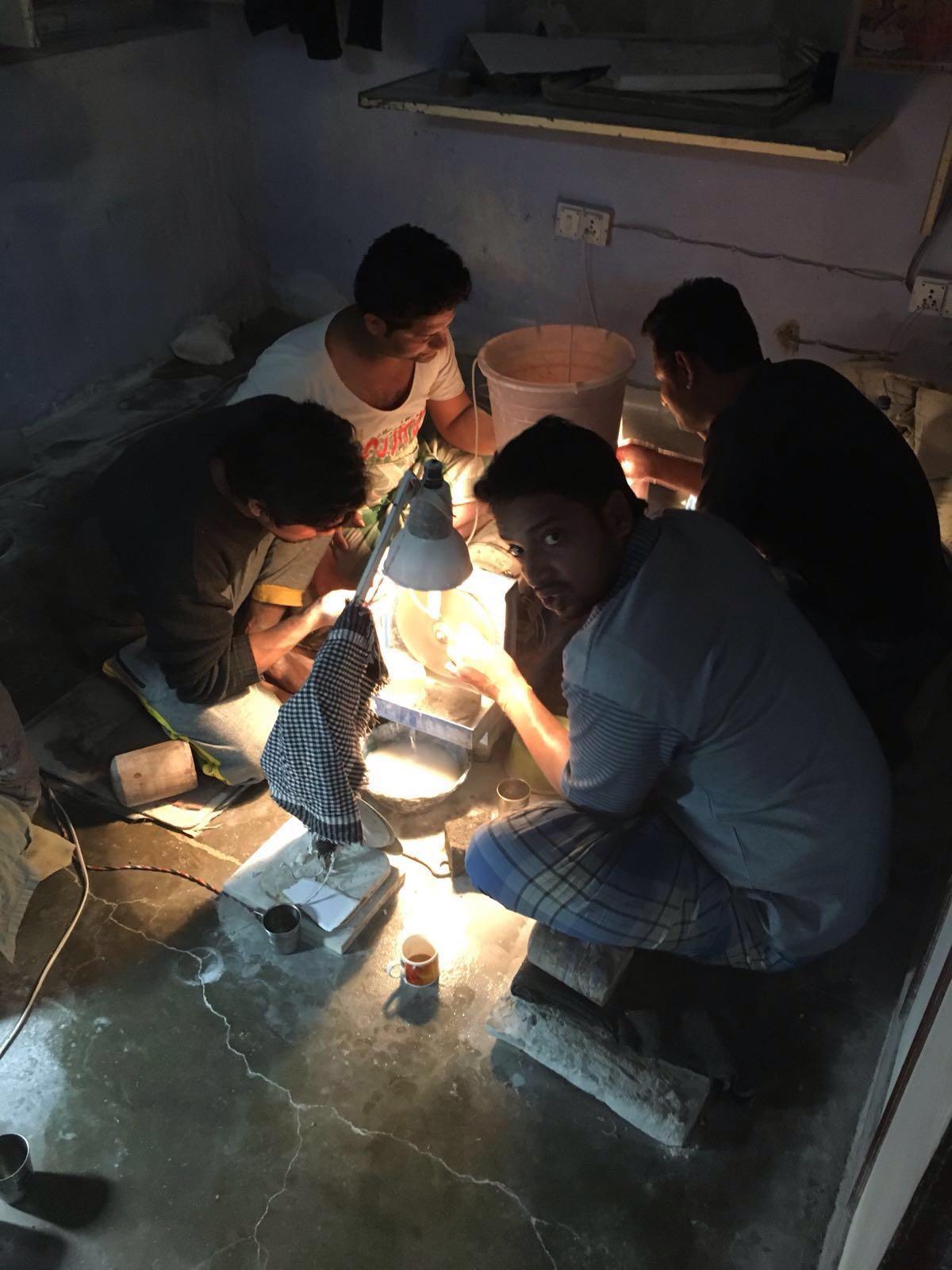 India labours polishing semi precious gemstones